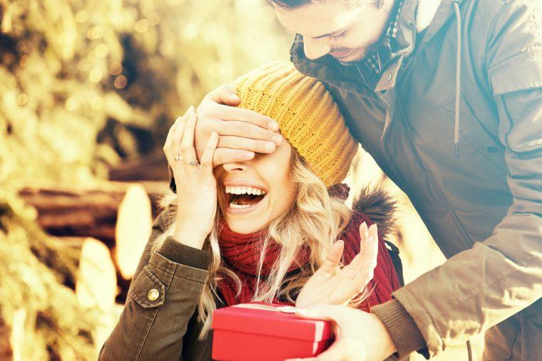 Happy couple giving Christmas gift